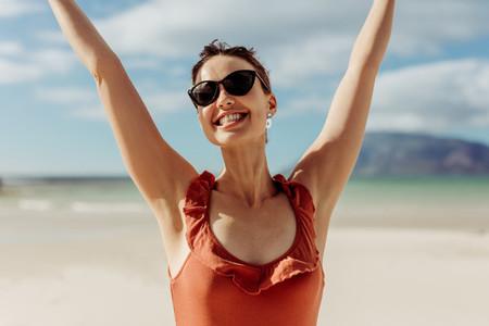 Woman on holiday enjoying at the beach