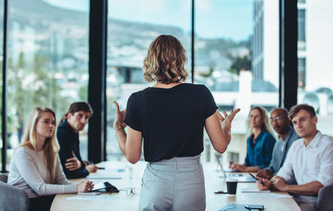 Businesswoman sharing new ideas in meeting