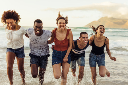 Group of friends having fun at the beach