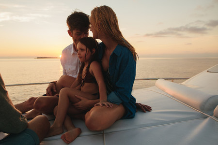 Family on a luxury travel on a yacht
