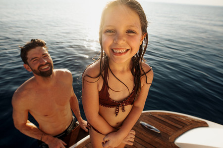 Kid having a great holiday on a yacht