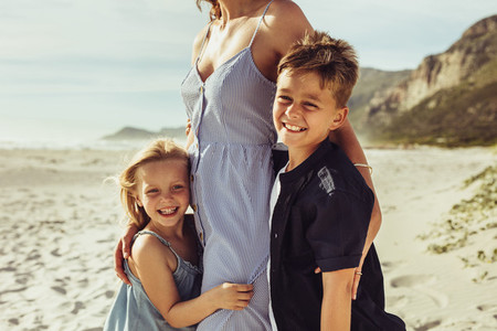 Kids with mother on the beach