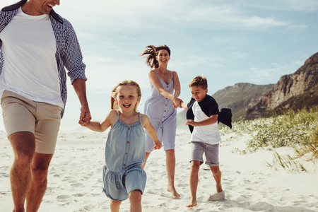 Kids having fun with parents on beach vacation