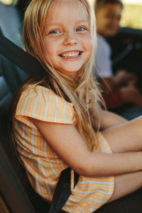 Beautiful girl travelling in backseat of the car