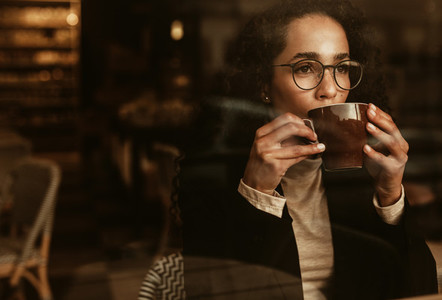Woman having coffee at a cafe
