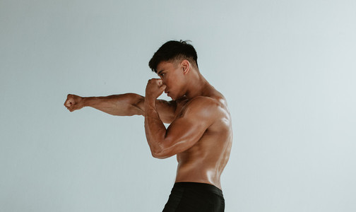 Muscular man shadow boxing