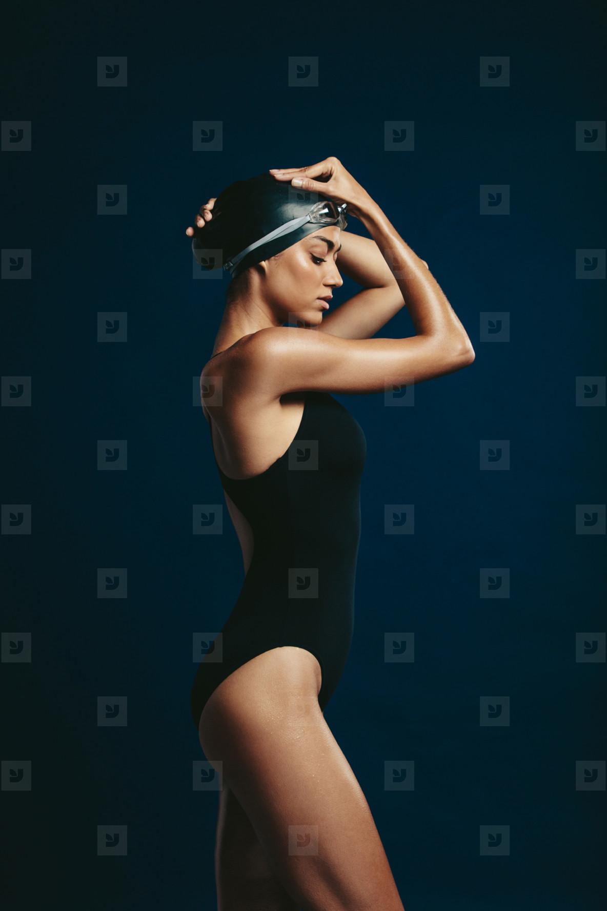 Fitness model in swimming costume