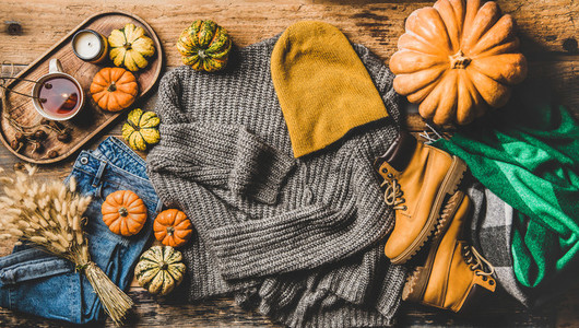 Autumn trendy women outfit layout over rustic wooden background