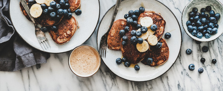 Breakfast banana pancakes with blueberry and cup of coffee