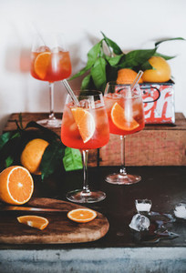 Aperol Spritz aperitif drink in glasses with oranges and ice