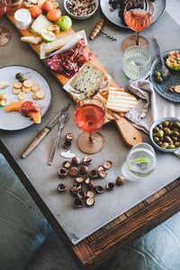 Picnic with rose wine cheese charcuterie appetizers and fresh fruits