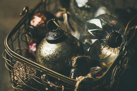 Christmas or New Year holiday decoration balls in copper basket