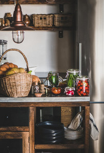Fresh ingredients and glass jars with homemade vegetables preserves