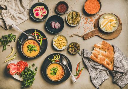 Turkish traditional yellow lentil soup Mercimek  flatbread  vegetables and spices