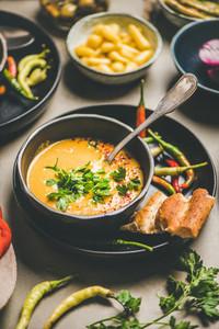 Turkish lentil soup Mercimek with parsley in black bowl