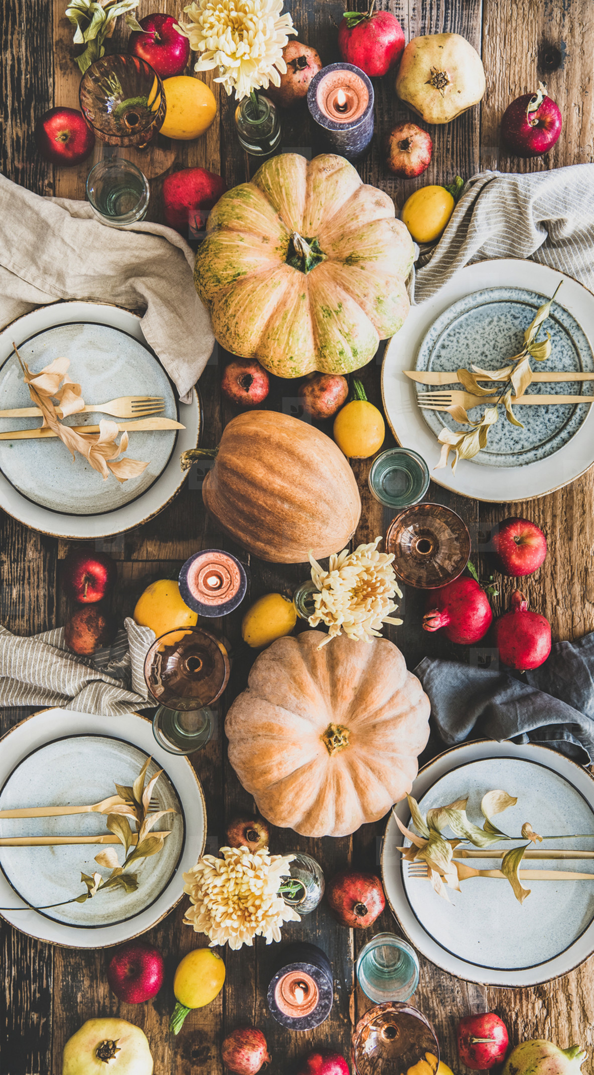 Table setting for Thanksgiving day party with fruits and candles
