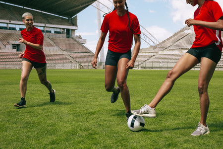 Women playing soccer on the field