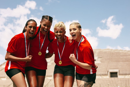 Female football team celebrating the victory