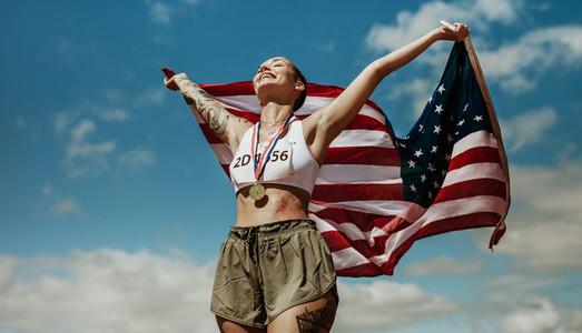Athlete enjoying victory with US national flag