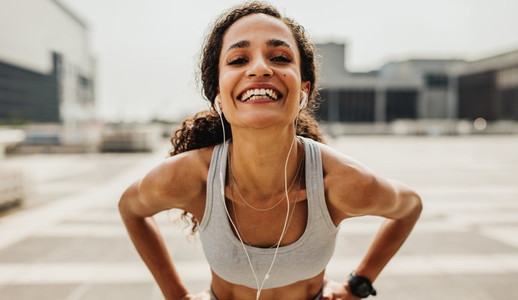 Cheerful female runner in the city