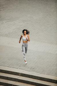 Fit woman sprinting in the city
