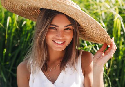 Beautiful blond woman in hat