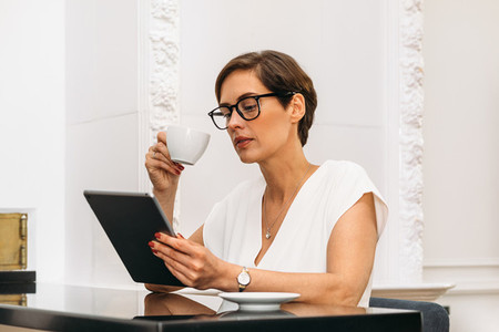 Mid adult woman holding a cup