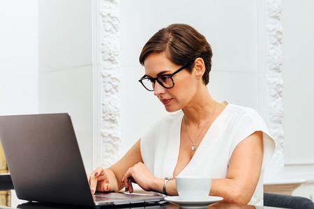 Caucasian woman typing on laptop