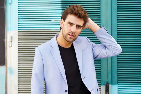 Attractive man wearing suit standing in urban background