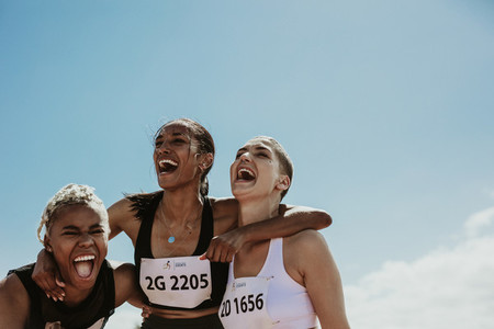 Group of female runners enjoying victory