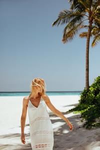 Woman on a tropical beach vacation