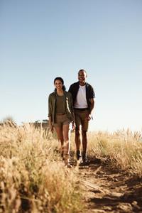 Couple enjoying hiking down a hill
