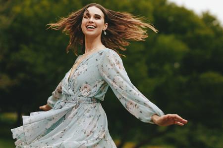 Pretty woman dancing outdoors