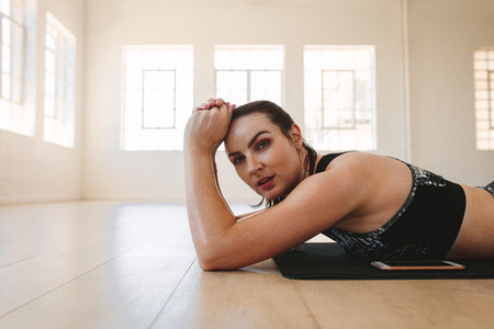 Fit woman relaxing after workout