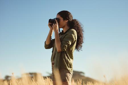 Female taking photos outdoors