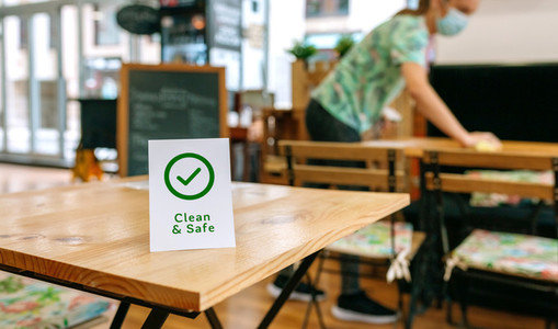 Clean and Safe sign placed on a table