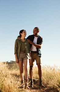 Couple hiking on rough terrain