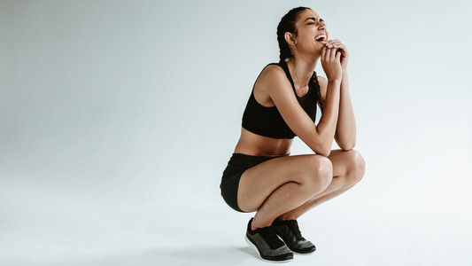 Sportswoman taking rest after workout