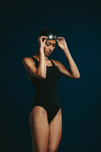 Woman in swimsuit on dark background