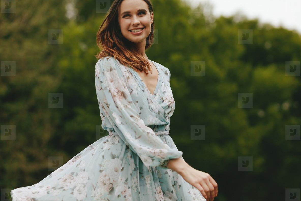 Beautiful woman dancing in the park