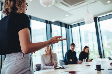 Businesswoman making a presentation to her colleagues in office