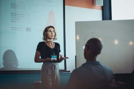 Woman addressing a business conference