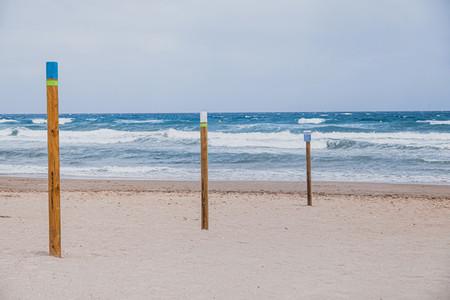 Empty beach with sunbeds an umbrellas