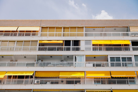Apartment building pattern balconies near a beach
