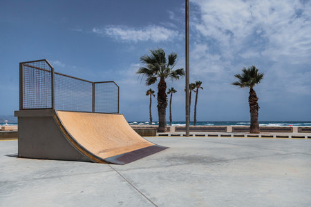 Empty skate park ramp outdoor in seaside beach