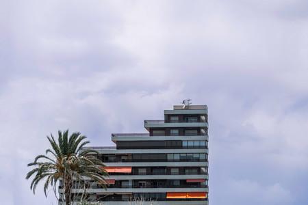 Apartment building pattern balconies near a beach