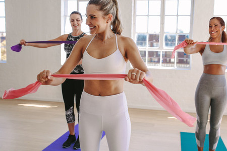 Women working out with stretch bands