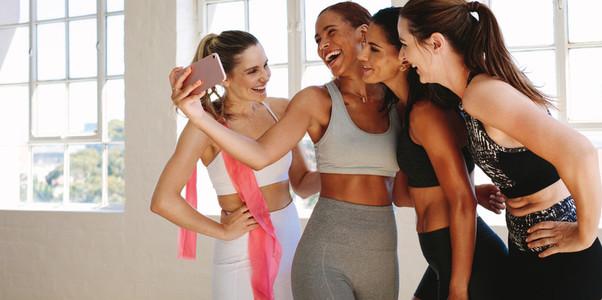 Women having fun at the gym