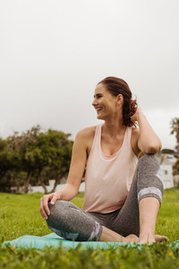 Smiling woman enjoying fitness session in park