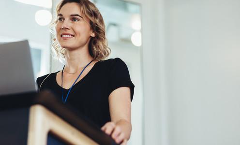 Female entrepreneur on podium in conference
